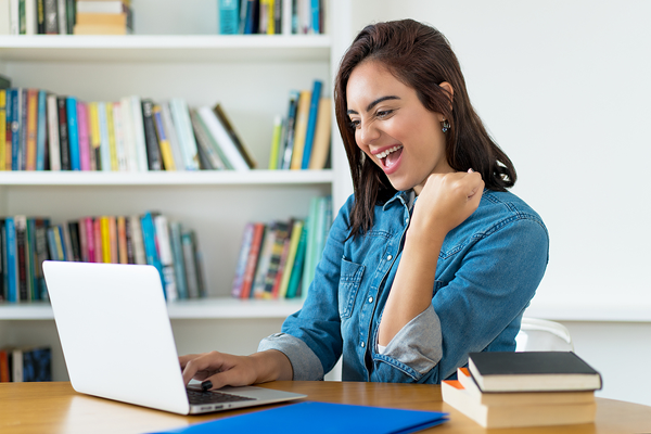 happy woman looking at school website