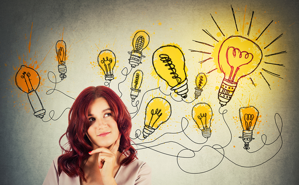 woman surrounded by light bulbs representing ideas
