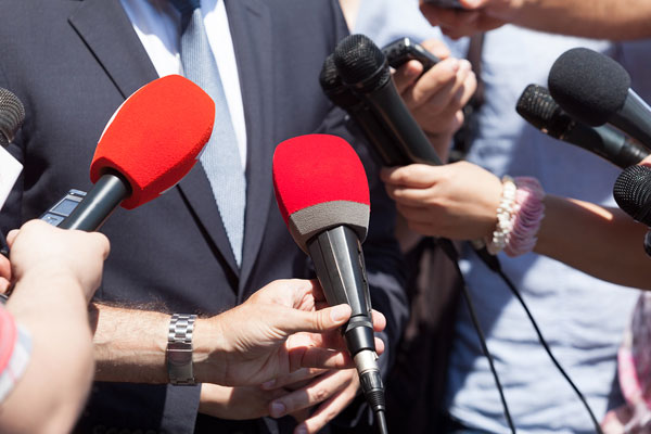 journalists with microphones