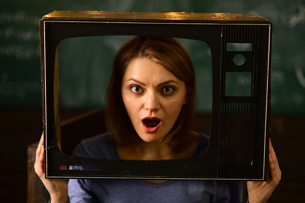 girl's face looking out of old-fashioned TV screen