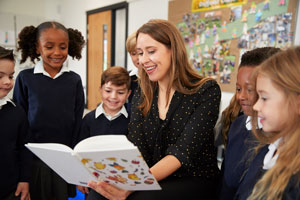 woman reading to students