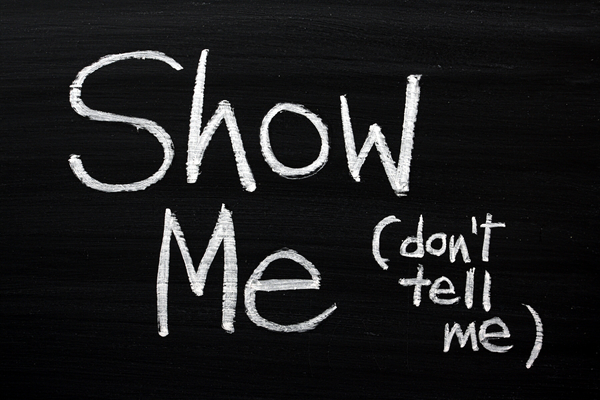 Show me, don't tell me written on chalkboard