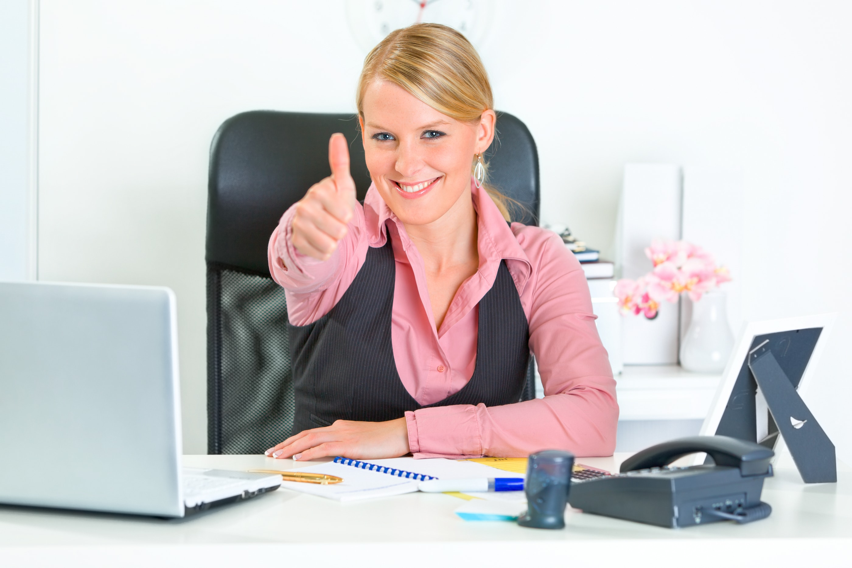 Image of woman at desk giving thumbs up for ADA website compliance