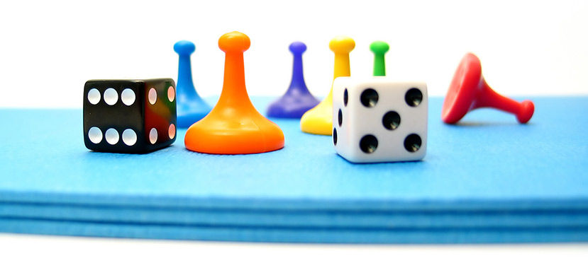 dice and game pieces on a table