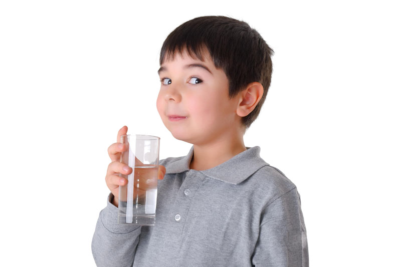 Boy drinking clean water from a pure source