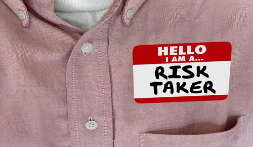 Name tag with the words Risk Taker on it