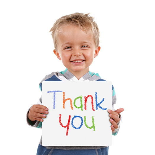 Little boy holding sign that says Thank You