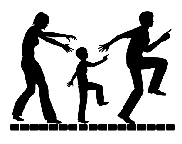 silhouette of parents with child