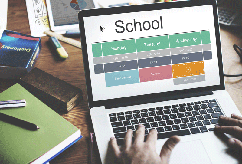 Image of laptop showing school calendar