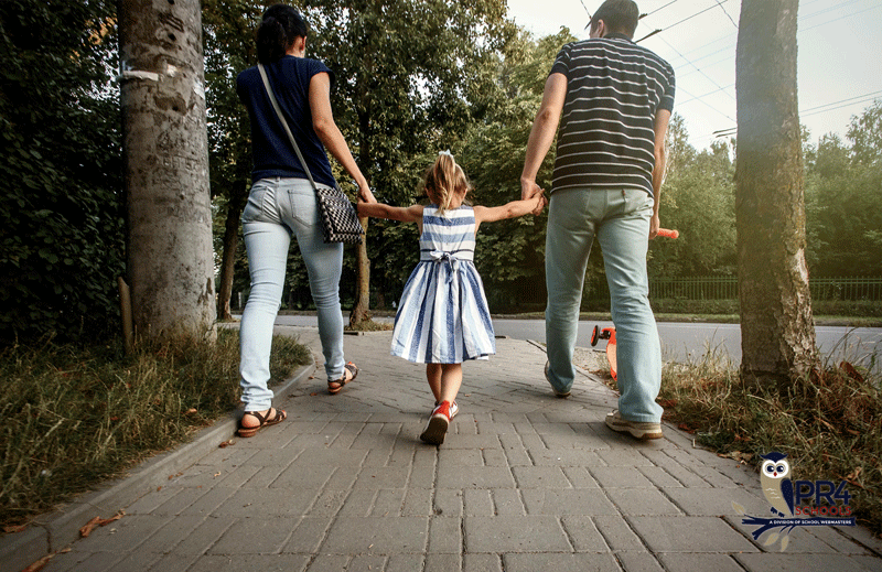 Mother and father holding child's hand
