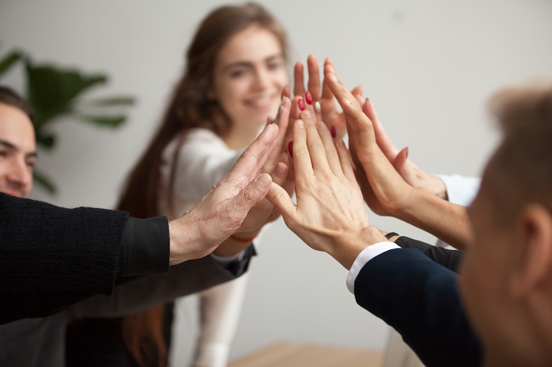 accessibility team shows motivation with group high five