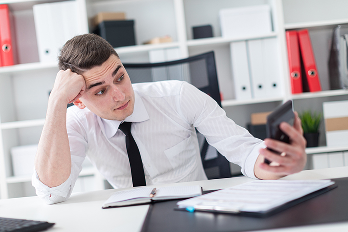 employee looking at calculator worried about accessibility budget