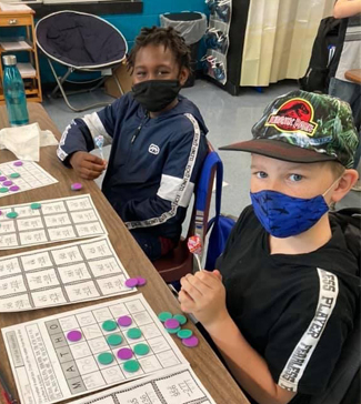 Students playing math games