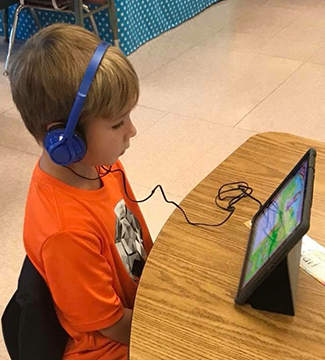 Student uses tablet in classroom