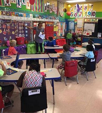 Teacher speaks to children