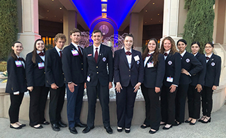 HOSA members pose in front of a fountain