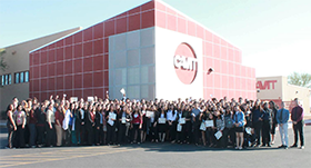 Large group poses in front of CAVIT