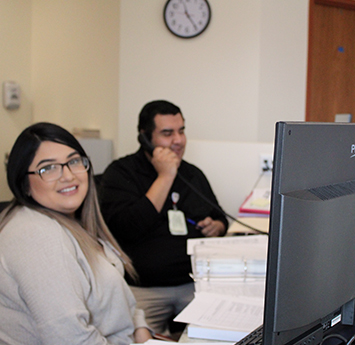 Brianna and Arturo working at the clinic