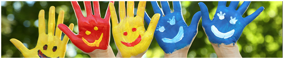 Hands with smiley faces painted on them