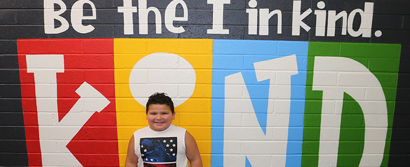 Be the I in kind banner with student in front