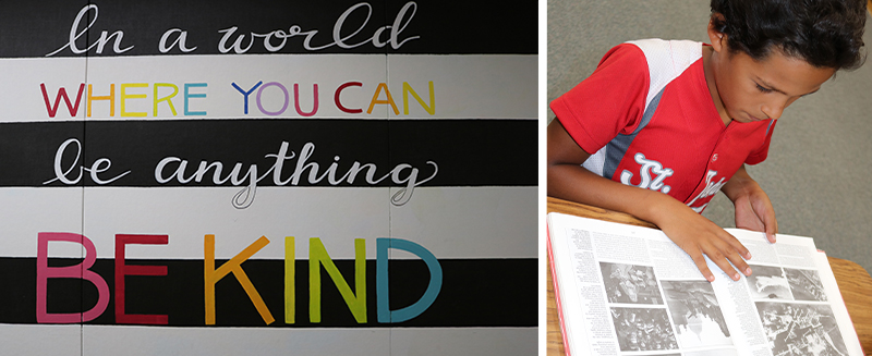 In a world where you can be anything, be kind - student looking at photos