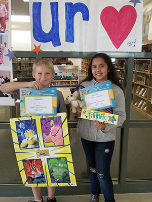 two students with awards