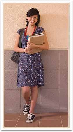 female student leaning on wall