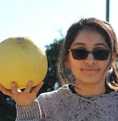 girl holding a melon