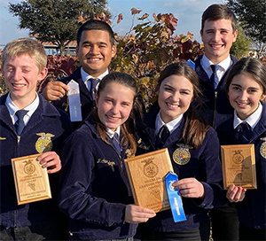 six FFA students with ribbons and plaques