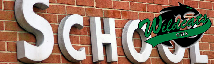 building sign says school and Countryside High School Logo