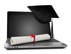 Laptop, mortar board and diploma
