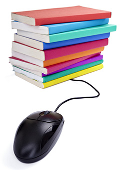 Stacked books and a computer mouse