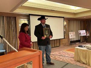 Ty White accepting ARSA Teacher of the year award