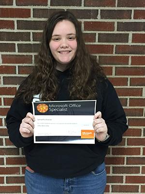 Samantha Kermer holding her certificate
