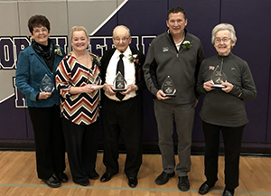 2018-2019 North Cedar Alumni Award recipients holding their awards