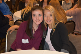 North Cedar FBLA member Fiona Raney smiles with Julia Campbell, former Miss Teen Iowa.