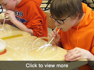 View more photos of students working on Pi Day Classroom Assignment