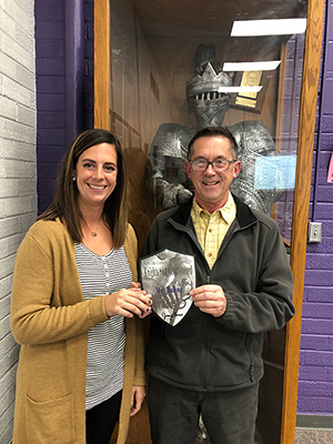 Randy Behne with the KNIGHT ARMOR award at the North Cedar School Board meeting