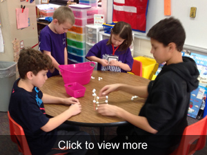 View more photos of the students building towers