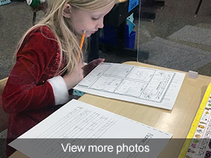 View more photos of first graders working on their personal narratives.