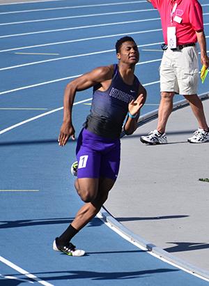 Greg Hansen running the 200 meter dash