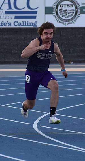 Miles McCollough running in the 100 meter dash