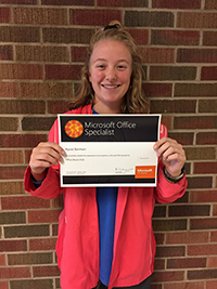 Alyssa Barnhart holds up her certificate for passing the Microsoft Office 2016 Word Specialist exam