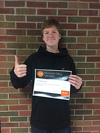 Jacob Spahr holding his certificate for the Microsoft Office 2016 Excel Specialist Exam