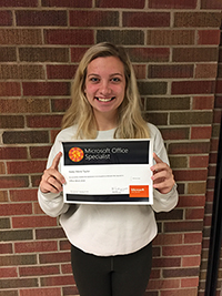 Kealy Taylor holds up her certificate for passing the Microsoft Office 2016 Word Specialist exam