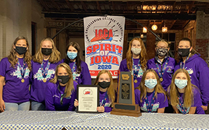 North Cedar Cheer team with state champion two trophies