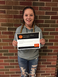 Tatum Slaton poses with her certificate