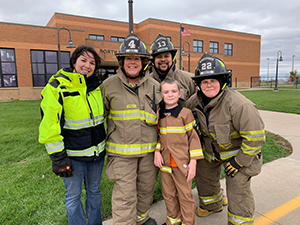 Firefighters and student
