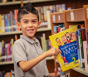 Boy Smiling with Book