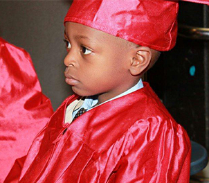 Little Boy in Graduation outfit